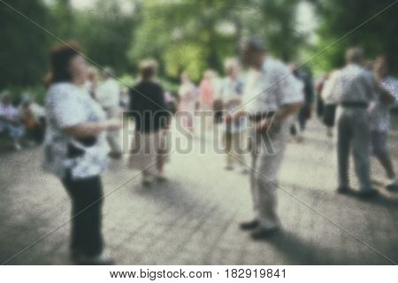 Dance older person: retro photo background. Old people- active dancing couple in the park. stock photo