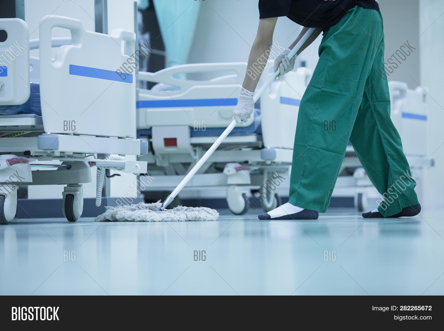 adult,bucket,building,business,care,caucasian,charlady,charwoman,clean,cleaner,cleaning,cleanness,clinic,corridor,dust,equipment,factory,female,floor,girl,hall,hospital,industrial,instruments,job,lady,lifestyle,maid,medical,mop,occupation,pass,passage,people,person,purity,rag,routine,service,standing,sterile,technology,uniform,washer,washing,white,woman,work,worker