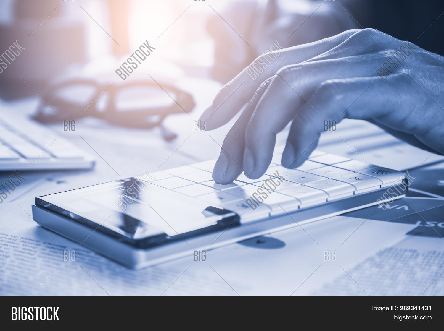 usinessman or accountant working on calculator to calculate accounting and business finance plan sales. Accounting,investment advisor consulting on the financial report and plan a marketing plan at office. Business accounting plan idea concept.