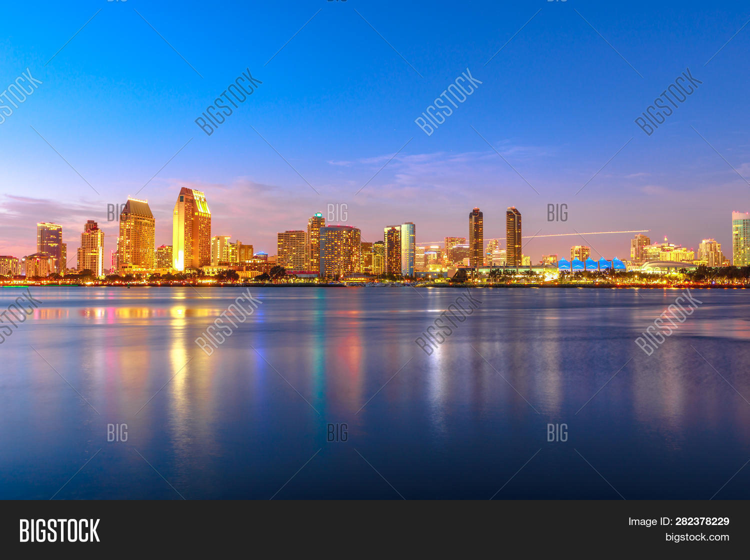 Panoramic Landscape Of San Diego Skyline With Illuminated Skyscrapers Reflecting In San Diego Bay At