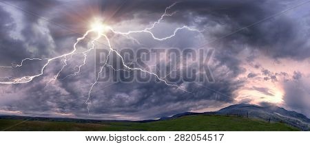 Scary clouds scenic natural phenomena in a cloud of black and white shades and dazzling colors - clouds after rain and bad weather in the storm with lightning over the mountains stock photo