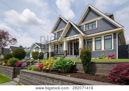 Luxury Residential House With Front Yard Over Land Terraces. Big Family House With Nice Landscaping