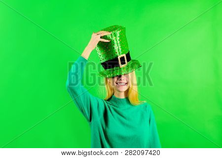 Patrick's Day. Green top hat. Girl in Leprechaun costume. Leprechaun. Green leprechaun. Green hat with clover. Saint Patrick's Day. Traditions of Saint Patrick Day. Sale. Discount. stock photo