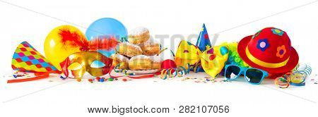 Colorful carnival or party background with donuts, balloons, streamers and confetti and funny face formed from wig, hat and eyeglasses isolated on white stock photo