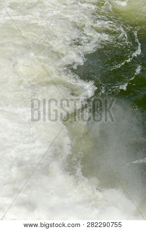 Natural background of fall water from spillway in the dam of resort village Pancharevo, Sofia, Bulgaria, Europe stock photo