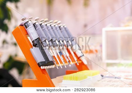 Modern and many kind of liquid or chemical transfer droplet gun single and multi channel adjustment pipette lab equipment for industrial chemical biochemistry medical food & beverage -cosmetics  etc. stock photo
