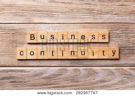 Business Continuity word written on wood block. Business Continuity text on wooden table for your desing, concept stock photo