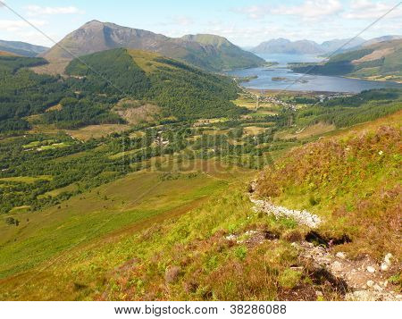 View of Scottish mountain Beinn a' Bheithir (mountain of the thunderbolt) from path up Pap of Glencoe stock photo