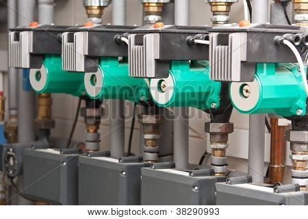 Modern boiler room equipment for heating system. Pipelines water pump manometers. stock photo