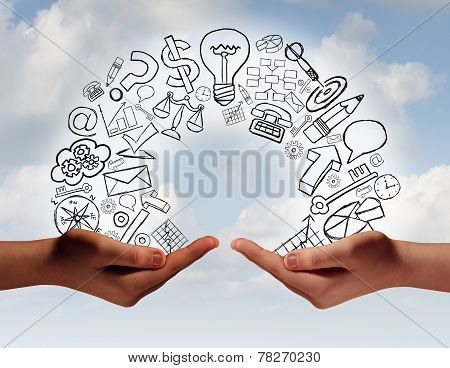 Business exchange concept as two human hands from diverse cultural backgrounds exchanging financial and economic information and training as a metaphor for team success. stock photo