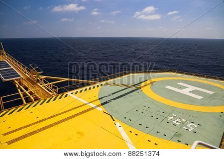 Helideck of oil and gas drilling rig in offshore industry, Helicopter landing area on construction platform in offshore of oil and gas industry or energy business for transfer passenger. ** Note: Visible grain at 100%, best at smaller sizes stock photo