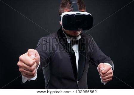 Exclusive guy driving invisible car and experiencing gaming thru vr galsses stock photo