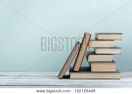 Stack of colorful books. Education background. Back to school. Book, hardback colorful books on wooden table. Education business concept. Copy space for text