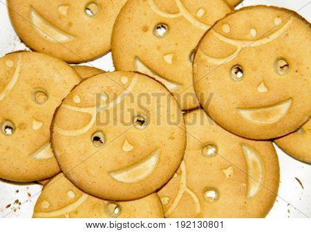 Background of the tasty round smiling cookies stock photo