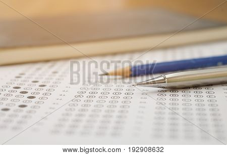 close up soft focus on Clutch-type pencil lay on exam test paper:blur picture concept. stock photo
