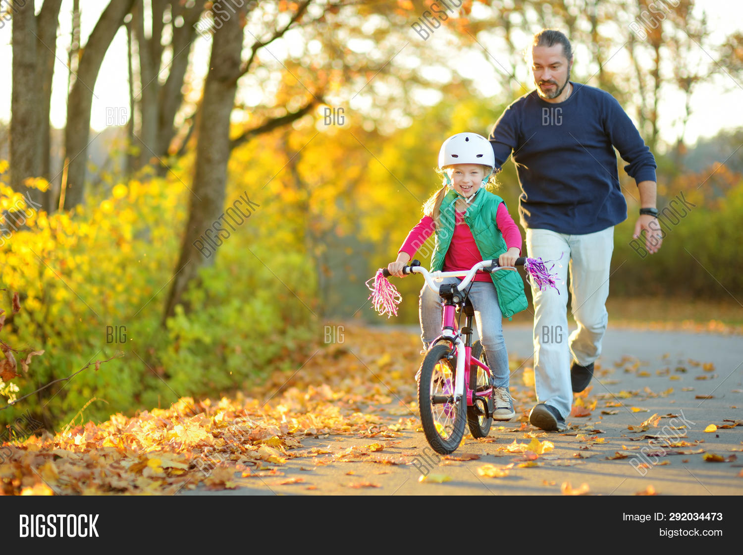 active,activity,adult,autumn,bicycle,bike,bonding,caucasian,child,city,cycle,cyclist,dad,daughter,day,enjoying,fall,family,father,foliage,girl,golden,helmet,help,joyful,kid,lane,leaf,learn,leisure,lifestyle,outdoors,parent,park,path,person,recreation,ride,road,safety,sports,street,teach,teacher,together,training,trust,wheels,yellow,young