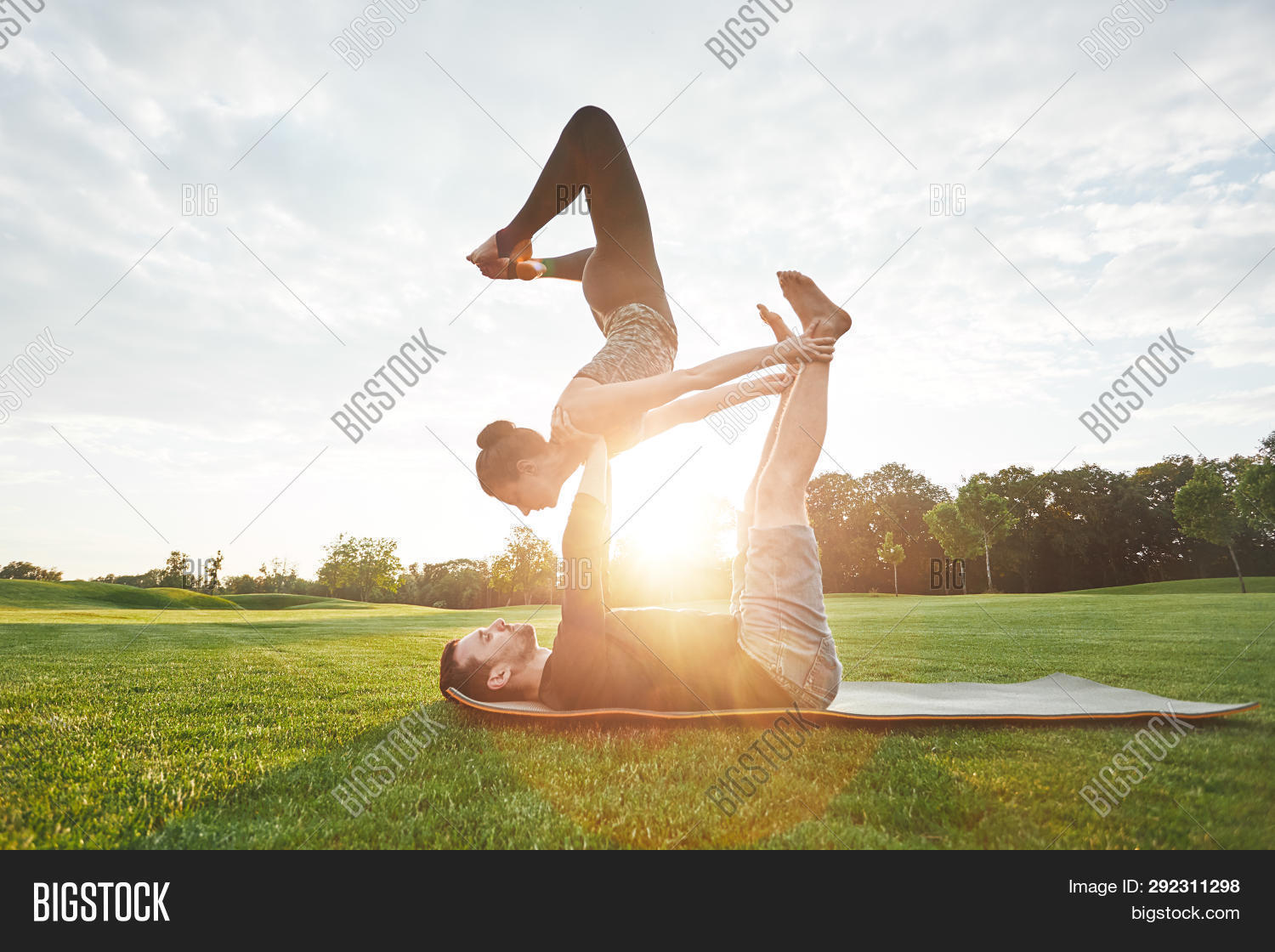 acro,acro-yoga,acrobatics,acroyoga,adult,balance,beautiful,beauty,body,care,caucasian,copy,couple,exercising,feet,female,fit,flexibility,flexible,grass,hands,healthy,holding,horizontal,legs,lifestyle,lifting,male,man,morning,nature,outdoor,park,people,pose,posing,practicing,practising,side,space,strength,sunlight,together,training,two,woman,yoga,young