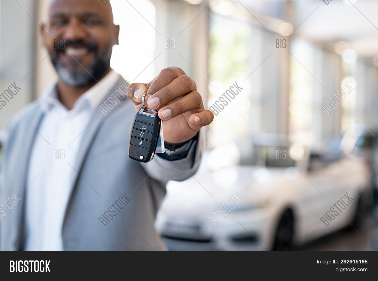 african,african american,agent,american,auto,automobile,black,business,business man,buy,buyer,car deal,car dealer,close up hand,closeup,copy space,customer,dealer,dealership,give,giving,hand,happy,holding,key,lock,luxury,man,mature,new,new car,owner,people,purchase,remote,rental,rental car,sale,salesman,salon,security,sell,seller,service,showing,showroom,toothy smile,transport,transportation background,vehicle