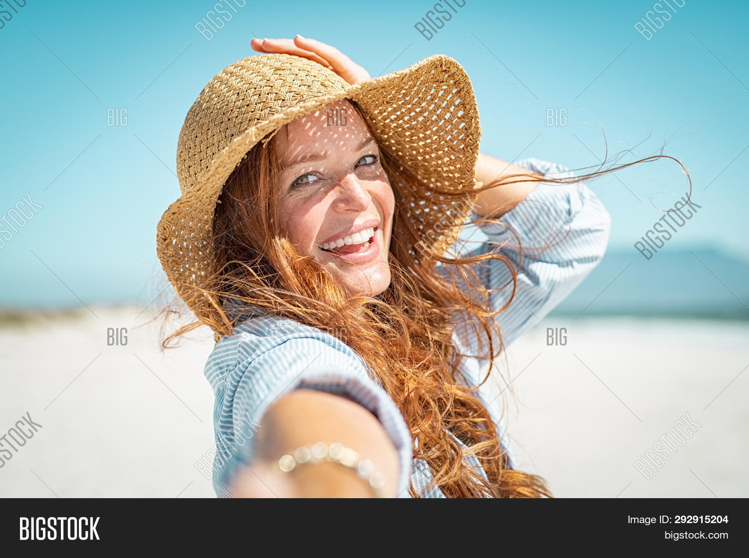 40 years,beach,beautiful,beauty,care,carefree,caucasian,cheerful,closeup,enjoy,face,freckles,girl,hair,happy,hat,having fun,holiday,joyful,laughing,lifestyle,looking,looking at camera,mature,mid adult woman,middle aged woman,natural,outdoor,people,portrait,protection,red,red hair woman,sea,skin,skin care,skincare,smile,straw,straw hat,summer,sun,sunbath,sunscreen,toothy smile,travel,vacation,wind,woman,young