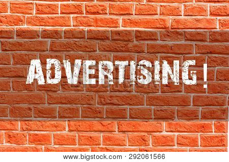 Writing note showing Advertising. Business photo showcasing Reach out world branding with digital marketing optimization Brick Wall art like Graffiti motivational call written on the wall. stock photo