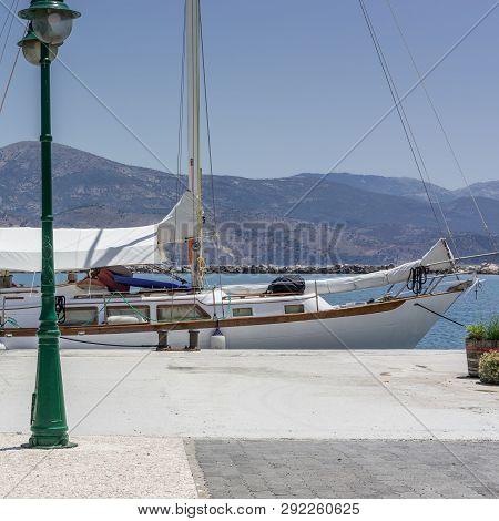 Sailboat yacht docked Lixouri Kefalonia Greece summer, green lantern stock photo