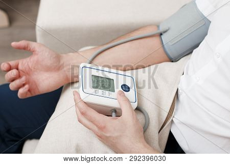 Measurement of blood pressure by an electronic tonometer. stock photo