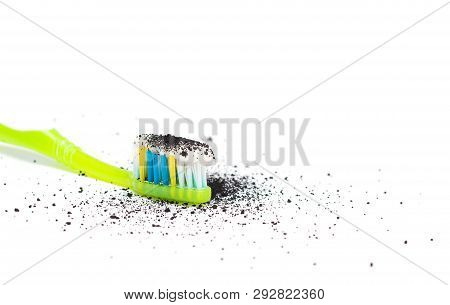 Toothbrush with toothpaste with the addition of activated carbon and Babmuk coal on a white background, for the treatment of gums of teeth and whitening, close-up, isolate stock photo