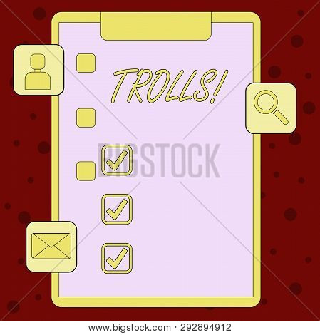 Handwriting text Trolls. Concept meaning Online troublemakers posting provocative inflammatory messages Clipboard with Tick Box and 3 Apps Icons for Assessment, Updates, Reminder. stock photo