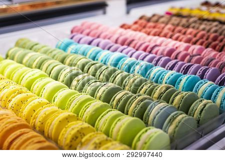 Colorful french macarons background, close up. Different colorful macaroons background. Tasty sweet color macaron, Bakery concept. Selective focus stock photo