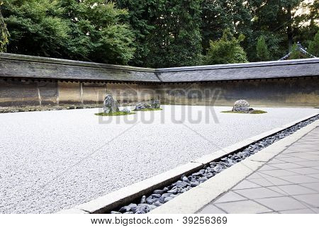 Rock garden (also called a Zen Garden) at the Ryoan-ji temple in Kyoto Japan. stock photo