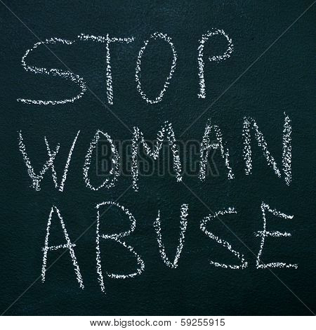 sentence stop woman abuse written with chalk on a chalkboard stock photo