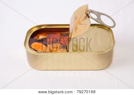 Mussels in a tin with a brown escabeche sauce of vinegar oil and garlic. Isolated on white stock photo