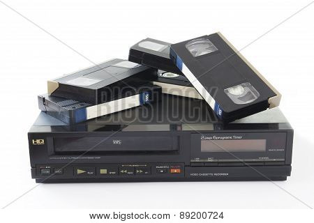 Old VHS Video Cassettes on Old Video Recorder Isolated on White Background. stock photo