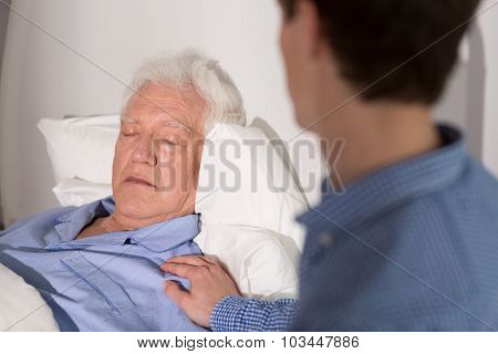 View of an elder man falling asleep and his relative stock photo