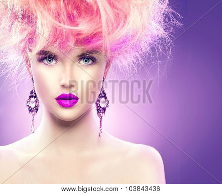 High Fashion Model Girl with pink color Updo hairstyle and bright make up. Beauty woman with glamour hairdo hair style, stylish makeup and accessories. Beauty Lady portrait stock photo