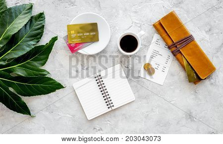 Pay restaurant bill. Bill, bank card, wallet, coins near cup of coffee on light table top view.