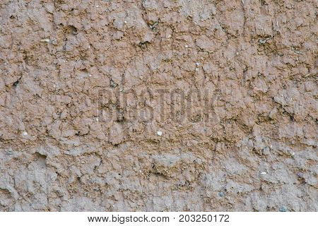 Old clay wall. The texture of the old clay wall stock photo