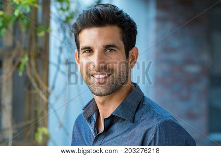 Handsome mid adult man smiling and looking at camera. Portrait of happy young casual man. Close up p