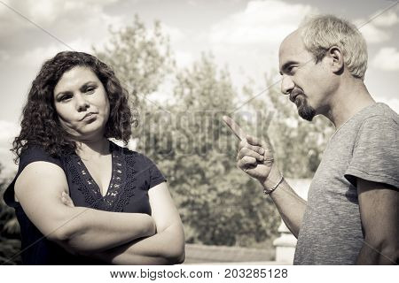 Couple in negative attitude angry transmitting emotional tension stock photo