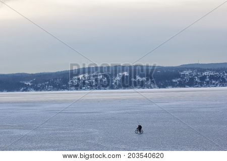 Man cycling on an iceberg on oslofjord norway stock photo
