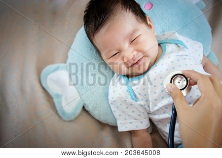 healthy people concept. Asian adorable baby infant laughing with happy face for good health on doctor check up time