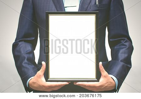 Special offer. Top manager award mockup. Best office employee award. Business man holding in hands empty blank photo frame. Gratitude concept. Grateful letter.