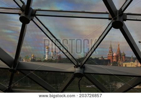 View to Kremlin through the glass roof of modern park Zaryadye in Moscow Russia stock photo