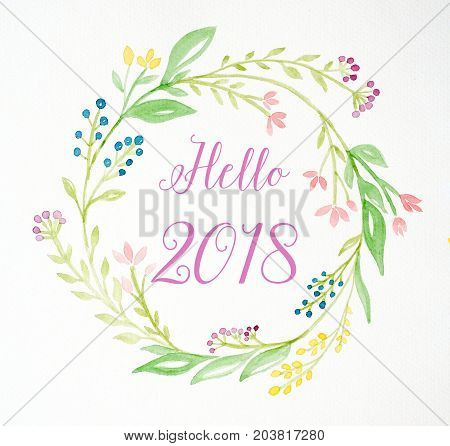 Hello 2018 on hand painting flowers wreath in watercolor style over white paper background flowers wreath new year greeting card