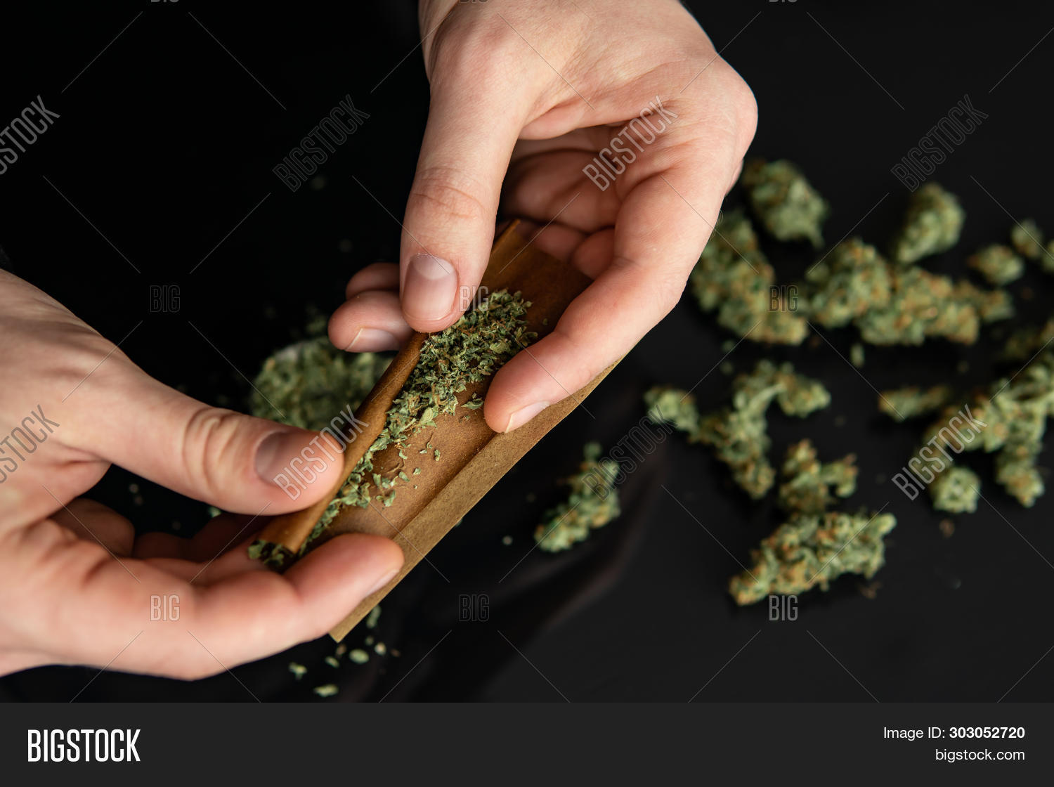 addiction,alternative,background,cannabis,cigarette,closeup,drug,filter,grass,habit,hand,hashish,illegal,joint,leaf,marihuana,marijuana,medicine,narcotic,paper,person,pot,roll,rolling,smoke,smoking,tobacco,unhealthy,up,weed