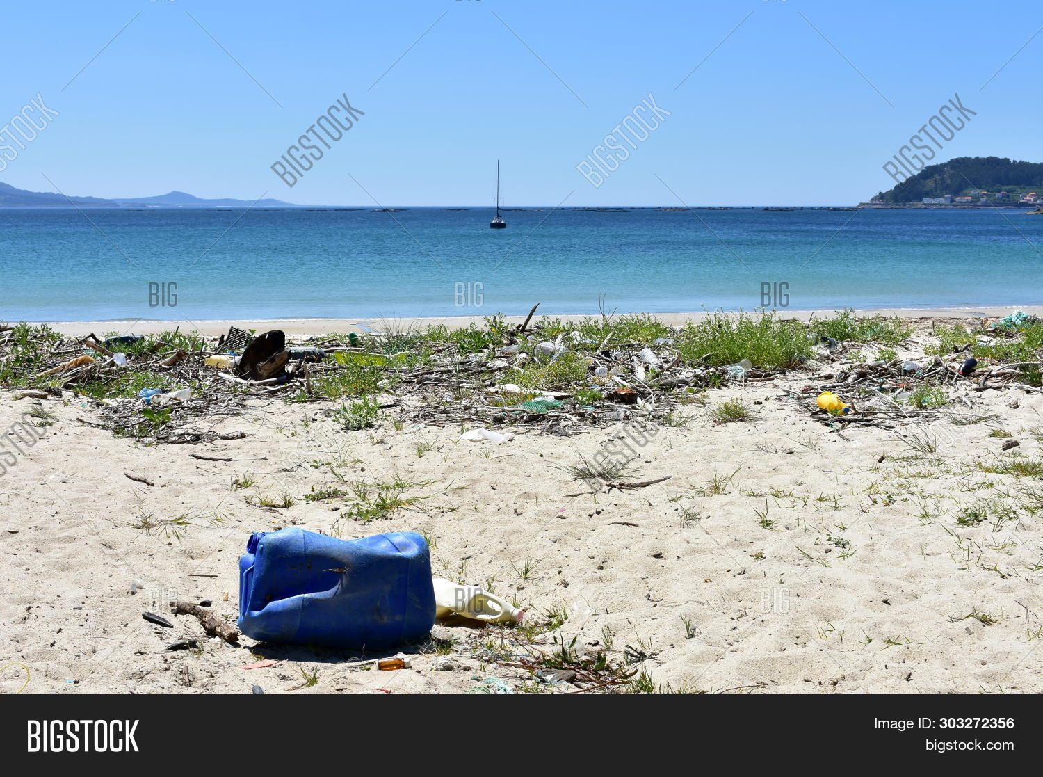 Dirty beach with plastic pollution. Galicia, Spain.