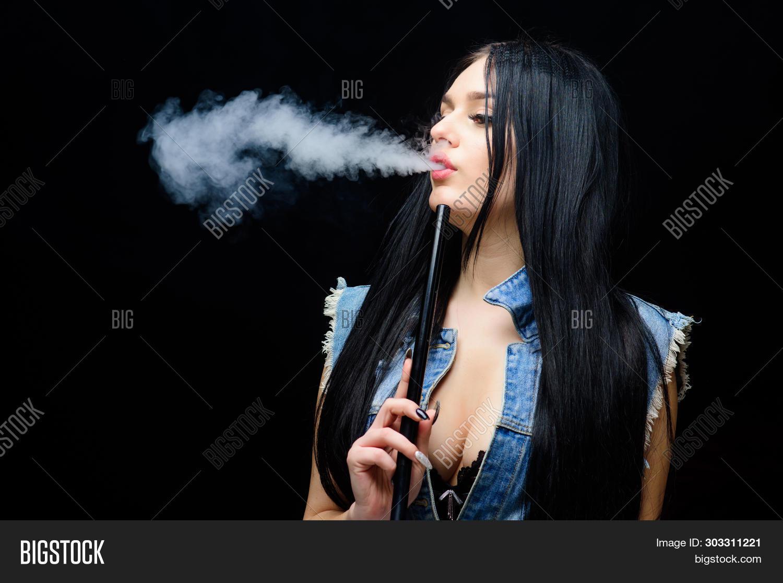 White Cloud Of Smoke. Vaping Is Sexy. Nicotine Addiction. Glamorous Brunette Smoking Vaping Device B