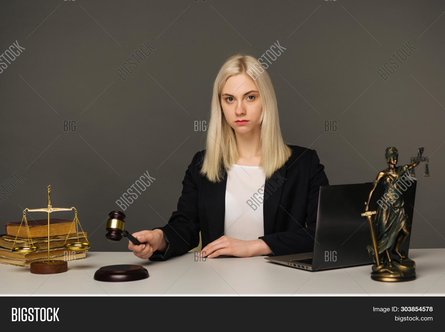 accountant,advocate,auction,block,clerk,court,courtroom,crime,criminal,decision,female,gavel,glasses,guilty,hammer,holding,judge,judgement,justice,law,lawsuit,lawyer,legal,litigation,magistrate,notary,office,person,robes,rules,sounding,stand,trial,wig,woman