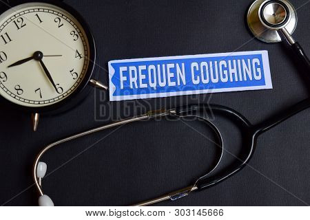 Frequen Coughing on the paper with Healthcare Concept Inspiration. alarm clock, Black stethoscope. stock photo