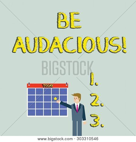 Handwriting text Be Audacious. Concept meaning Takes risks in order to achieve something Unconventional Daring Businessman Smiling and Pointing to Colorful Calendar with Star Hang on Wall. stock photo